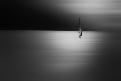 Lake Garda sail boarder (www.streetphotography-berlin.com) Tags: sailboarder lake garda italy light backlight silhouette monochrome blackandwhite blackwhite streetphotography streetlife fineart