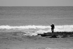 A Fisherwoman's Sunday (idris.photography) Tags: canon 800d fishing bw blackandwhite ocean sea southchinasea brunei rocks waves