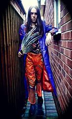 Lord Josh Allen - Colourful Non Conformist (lordjoshallen) Tags: lordjoshallen lordjosh cosplay cosplayer costume colourful orange purple vivid creativity striking clothing clothes longhair leather longcoat urban street city nature kongmingfan