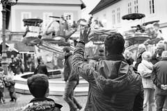 """Hi"" (Mister G.C.) Tags: street urban photography blackandwhite bw canon canonae1 canonae1program 50mm f18 50mmf18 primelens manual manualfocus slr streetphotography urbanphotography shot image photograph candid people frombehind wave waving handgesture gesture fairground fair funfair monochrome town city vintage analog analogphotography 35mm film schwarzweiss strassenfotografie mistergc germany niedersachsen lowersaxony deutschland europe"