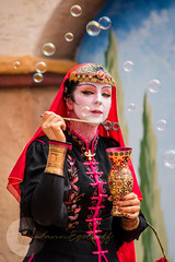 Serendipity (Bubbles) (Paulann_Egelhoff) Tags: paulann paulannegelhoff professional photography art design phoenix arizona az renfair renaissance renaissancefestival renaissancefair vaudeville circus family familycircus clan tynker clantynker juggle juggling rings ring bubbles poi unicycle accordion knives mask dance jester outfits period periodpieces colors colorful color vivid bright motion movement blur capture photo headshot action outdoors fun