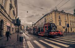 In the streets of Krakow (Vagelis Pikoulas) Tags: krakow poland road street travel tram traffic girl woman clouds november autumn 2017 city cityscape urban tokina 1628mm canon 6d