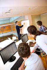 Teacher in lab doing presentation on whiteboard (cfdtfep) Tags: teacher class education school college university young people youth students girls boys group team workmates classmates classroom lesson conference presentation businessclass trade finance management desktop computer computing science lab screen computerscience sitting indoors adult teens teenagers training meeting educator trainer apprenticeship whiteboard teaching presenting board business france