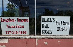 I've got good news, and I've got bad news (Monceau) Tags: abbeville louisiana receptions banquets bail bonds signs windows