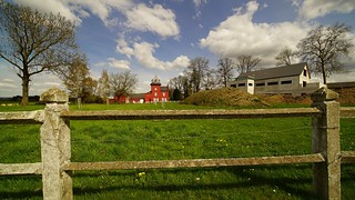 red House Behind a Fence