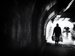 going home after shopping (Sandy...J) Tags: atmosphere alone atmosphäre allein blackwhite bw black city contrast silhouette deutschland darkness dark dunkelheit durchgang tunnel urban underpass unterführung light licht monochrom man mann germany gehen gegenlicht backlight winter noir olympus fotografie photography passage street streetphotography sw schwarzweis strasenfotografie stadt