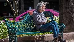 2018 - Mexico City - Roma Norte - Plaza Luis Cabrera (Ted's photos - For Me & You) Tags: 2018 cdmx cityofmexico cropped mexico mexicocity nikon nikond750 nikonfx tedmcgrath tedsphotos tedsphotosmexico vignetting luiscabrera plazaluiscabrera park romanorte parkbench parkscene inapark seating seated sitting male man denim denimjeans shoes book hoodie shadow glasses hair messyhair longhair