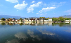 Honcun Bathing in Reflected Glory (Eye of Brice Retailleau) Tags: angle beauty composition landscape outdoor panorama paysage perspective scenery scenic view extérieur ciel sky backpacking earth travel vista reflection reflet mirror colourful colours clouds light blue cloudscape water waterscape lake eau lac calme countryside village unesco heritage ancient asia asie china chine chinese honcun