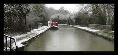Chesterfield Canal. The Snow And The Rain (M E For Bees (Was Margaret Edge The Bee Girl)) Tags: chesterfieldcanal water snow rain raindrops cold canon countyside landscape narrowboat towpath bare trees black white red grey stone wall