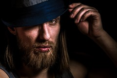 Attention (Zscherny) Tags: mann man porträt portraiture portrait dynamic contrast eyes eye beard hair skin digital flash lightroom light walimex hat head close up low key nikon
