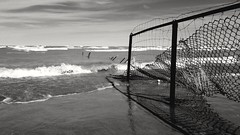 untitled (elaine layabout) Tags: bw chicago montrosedogbeach ice icicles waves fence spring
