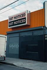 Get Noticed 50 50 (ADMurr) Tags: la midcity sign orange black blue leica m6 kodak 200 50mm summicron cbc402