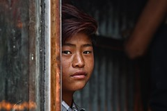Candle boy (dderici) Tags: monkeytemple kathmandu nepal candle boy buddha portrait nepali naturallight canon7d 70200