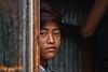 Candle boy (dderici) Tags: monkeytemple kathmandu nepal candle boy buddha portrait nepali naturallight canon7d 70200