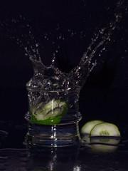 Tumbler Splash (minminatmidnight) Tags: fujifilmfinepixs100fs water wasser splash spritzer frisch fresh moment freeze einfrieren bewegung motion glas glass spritzen tropfen wassertropfen wasserspritzer drops droplets cucumber gurke salatgurke tumbler becherglas