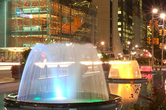 Tri-Colour Fountains. (avp17) Tags: blue light red urban toronto water fountain yellow night d50 nikon university downtown traffic queen beam fourseasons nikkor