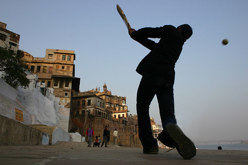 Boy playing cricket in India