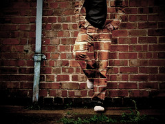 All in all... (Matt West) Tags: portrait wall topv2222 person bricks clothes jeans jacket camouflage drainpipe topf100 views5000 kkfav views10000 favorites70 favorites80