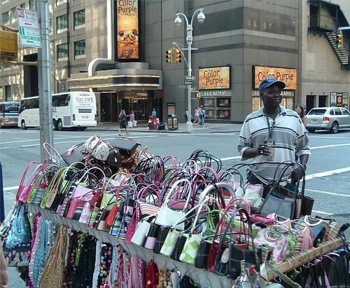 Gucci, Prada, Louis Vuitton! Get yer handbag here!