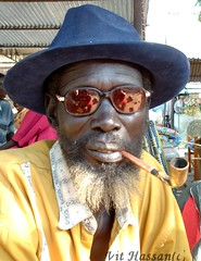 -Reflection- (Vt Hassan) Tags: africa people reflection hat sudan pipe southern tribe dinka theface glesses