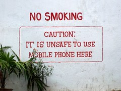 No smoking! Unsafe to use mobile phones! (Matthieu Aubry.) Tags: voyage trip travel india smoking mobilephones inde