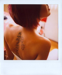 Marcy Shows Off Her Ink (Lou O' Bedlam) Tags: topf25 tattoo polaroid losangeles marcy polaroid680 louobedlam 62406photoshoot lounoble louobedlamcom