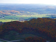 View From The Pinnacle II (mightyquinninwky) Tags: autumn trees red orange sunlight mountains green fall yellow buildings tn kentucky ky va roads overlook thepinnacle sceniclandscape southeasternkentucky