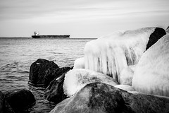 Small Ship, Big Rocks (tainkeh) Tags: 2018 spring landscape europa sailing water vehicle monday helsingør ship ocean øresund monochrome contrast container sail freight 365 danmark nature march transport 365project denmark europe helsingor oplevhelsingor oplevhelsingør landskab project365
