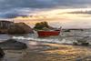 Sunset in Gov Celso Ramos Beach (rqserra) Tags: entardecer pordosol barco onda nuvens praia agua pedras paisagem sunset boat wave clouds beach rocks landscape rqserra brazil