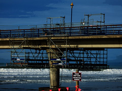 Repairing the Pier (Steve Taylor (Photography)) Tags: pleasekeepclear constructionoverhead bunting upright architecture construction scaffold scaffolding black blue red white newzealand nz southisland canterbury christchurch newbrighton ocean pacific sea surf waves pier repair stevetaylor