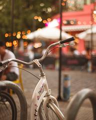 The flowery bike (ninasclicks) Tags: bicycle bike bokeh dof citylights dusk flowery flowerybike