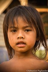 IMG_0261 (Sébastien Pagliardini) Tags: portrait cambodge laos lao camobodia asia asie trip tour world asean thailand thailande child children village people khmer heritage culture bike kompong cham phonm penh kampot cat water mekong sekong kep siem reap reab ball eyes man viet nam urbain smiling sourire monk asiedusudest