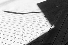 20180406-_DSC6153 (Fabian Tomczyk) Tags: bw blackandwhite black white highcontrast gray shape ground tiles pattern shadows lines negativespace harshshadows harshlight edited lightroom adobe sony sonyalpha6000 sonya6000 alpha6000 a6000 alphadicted alphacollective minolta rokkor manualfocus city streetphotography