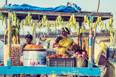 Frying Green Chilis By The Beach (Jon Siegel) Tags: nikon d810 50mm 14 sigma sigma50mmf14art man woman cooking chili peppers beach biryani sunset spicy people chennai india