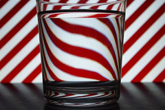 Through the glass (StartToFigureItOut) Tags: experiments red white striped diagonal water reversed distorted flipped glass cooph candy stripe 52in2018challenge diagonallines 31diagonal lines