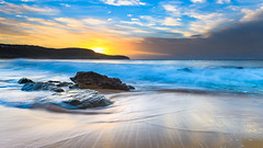 Rocky Sunrise Seascape with Clouds (Merrillie) Tags: daybreak sunrise cloudy australia nsw centralcoast clouds sea newsouthwales rocks earlymorning morning water landscape ocean nature sky waterscape coastal seascape outdoors killcarebeach dawn coast killcare waves