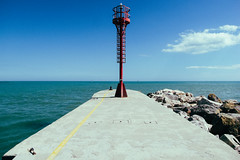 Cervia (lorenzog.) Tags: cervia beach beachlife spring lowseason ilobsterit path pathway rivieraromagnola emiliaromagna italy blue sky clouds canon molo dock marina marinadicervia lighthouse faro