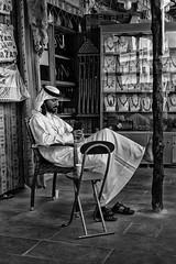Salesman in Souq Waqif (from Córdoba) Tags: qatar shopkeeper bw street