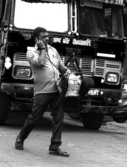 Mobile on the go (magiceye) Tags: mobile walk streetportrait streetphoto mumbai india monochrome blackandwhite bnw