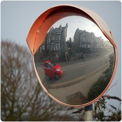 Reflections in red... (zapperthesnapper) Tags: redcar mirror car reflection mirrorreflection grangeoversands cumbria sonyimages sonyrx10 sonycybershot sony
