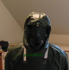 16 (gummifan61) Tags: rubberslave bondage rainwear