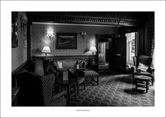 Makeney Hall lounge (G. Postlethwaite esq.) Tags: bw derbyshire makeneyhall sonya7mkii sonyalphadslr blackandwhite chairs fullframe hotel lounge mirrorless monochrome paintings photoborder tables