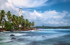 Dondra Lighthouse is a lighthouse located on Dondra Head, Dondra, the southernmost point in Sri Lanka (CreativePhotoTeam.com) Tags: clouds surfing surf wave nature horizon lanka sri lighthouse dondra beach travel ocean tropical coast beautiful palm sea shore landmark summer sky blue architecture tourism ceylon head galle rock asia tower navigation rocky white house island srilanka cape matara building light landscape tree view resort asian vacation travelling water holiday