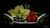 Blueberries and raspberries (Magda Banach) Tags: canon canon80d sigma150mmf28apomacrodghsm blackbackground blueberries colors flora flower green macro nature plants porcelain raspberries red reflection