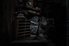 Catalantiquities (p.g604) Tags: palafrugell catalunya spain es catalantiquities antique market fan cupboard telephone desk shadows clock books dust dim