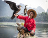 Wings (lc99photography) Tags: cormorantfisherman cormorantfishing cormorant wings motion landscape traditional oldman face portrait raft bambooraft river lijiang liriver guilin guangxi china travel arm handstand birds wildlife