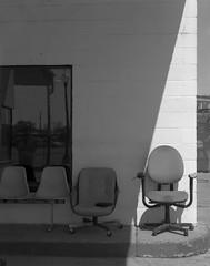 Splitting Chairs (GrantYoungFilm) Tags: film intrepid bnw blackandwhite ishootfilm filmisnotdead istillshootfilm analog analogue analogphotography delta100 iso100 symmar210 schneider rodenstock largeformat 4x5 hattiesburg downtown hubcity