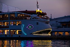 IMGP8247 Cruising the Saigon River (Claudio e Lucia Images around the world) Tags: saigon hochiminh hochiminhcity cruise boat sunset river cruisingboat pentax pentaxk3ii pentax18135 twilight water reflections