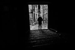 Girona Portal (p.g604) Tags: imgp9458edit girona portal doorway entrance cobbled street dark shadow light buildings spain spanish catalunya figure silhouette