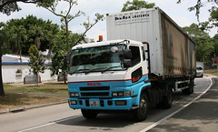 CHANGI Consignment (Jungle Jack Movements (ferroequinologist)) Tags: bbl singapore mitsubishi fuso changi prison museum pan asia logistics truck tractor prime mover diesel injected motor engine driver cab cabin fast brake wheel exhaust loud rumble beast hood hp horsepower gear oil haul haulage freight cabover trucker drive transport carry delivery bulk lorry hgv wagon road highway nose semi trailer double b deliver cargo interstate articulated vehicle load freighter ship move roll power grunt teamster
